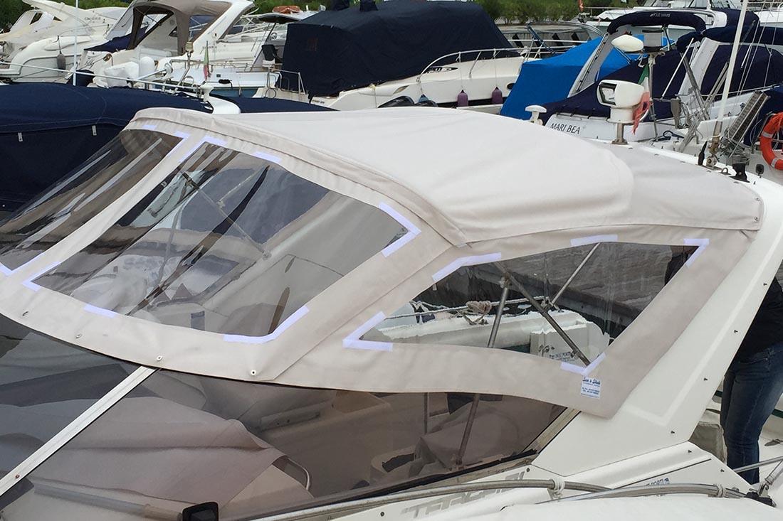 Sun & Shade di Genova realizza prodotti spray hood per barche a vela e il lazy bag che aiuta a riporre la randa sul boma